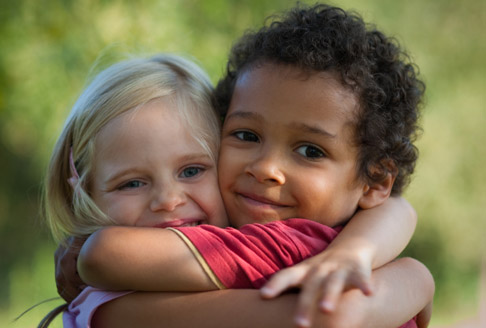 Image of two children hugging