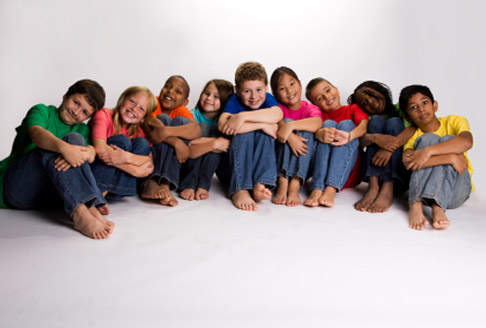 Image of nine children sitting on the floor