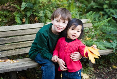 Images of boy and girl on a park bench